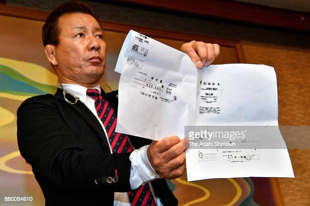 Takashi Hida a highranking official of the Liberal Democratic Party's Kishiwada branch shows receipts of a restaurant and a parking lot of 2013...