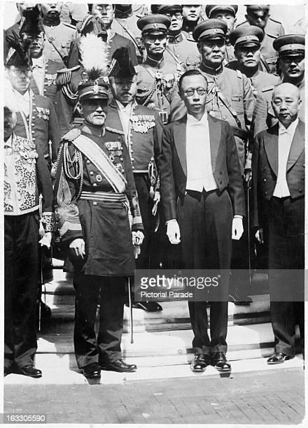 Takashi Hishikari in full military uniform pays his respect to Mr Henry PuYi in Japan 1955