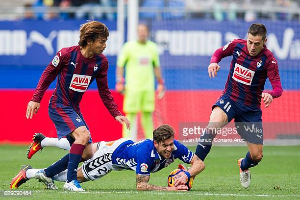 Takashi Inui and Ruben Pena of SD Eibar duels for the ball with Francisco Femenia of Deportivo Alaves during the La Liga match between SD Eibar and...