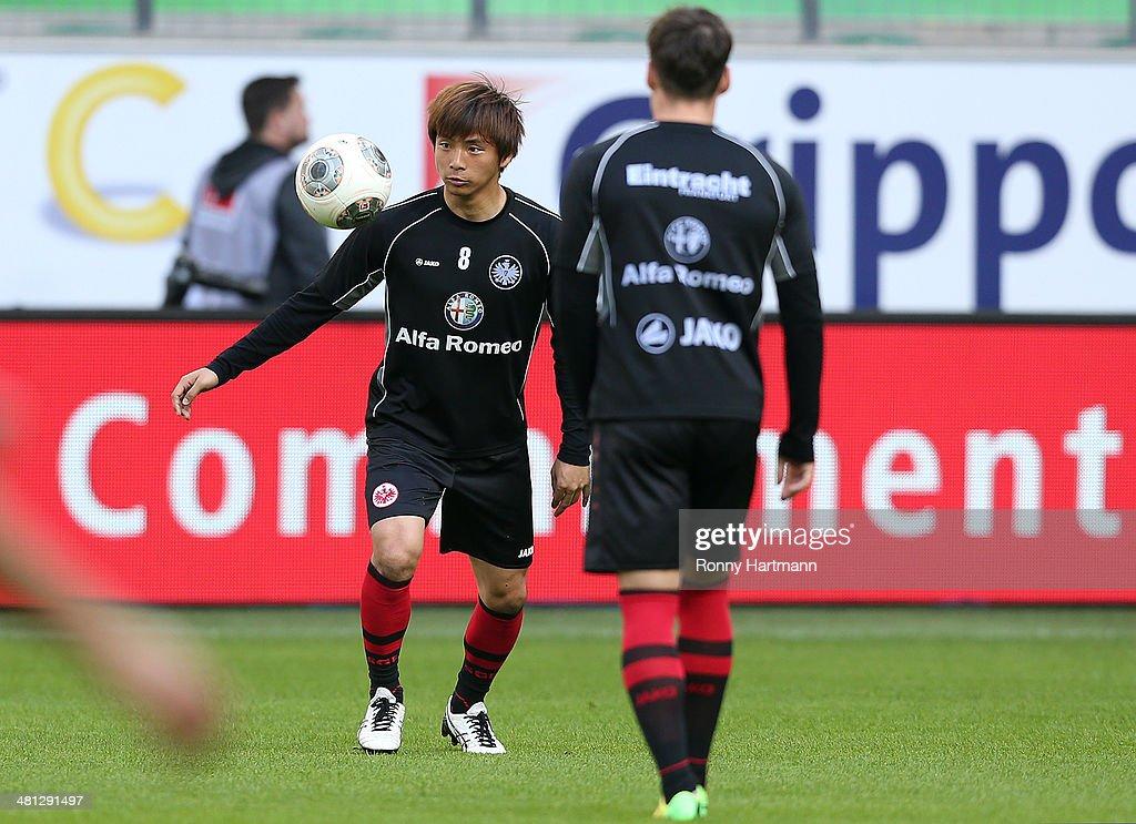 Takashi Inui and Stefano Celozzi of Frankfurt warm up prior to the Bundesliga match between VfL Wolfsburg and Eintracht Frankfurt at Volkswagen Arena...