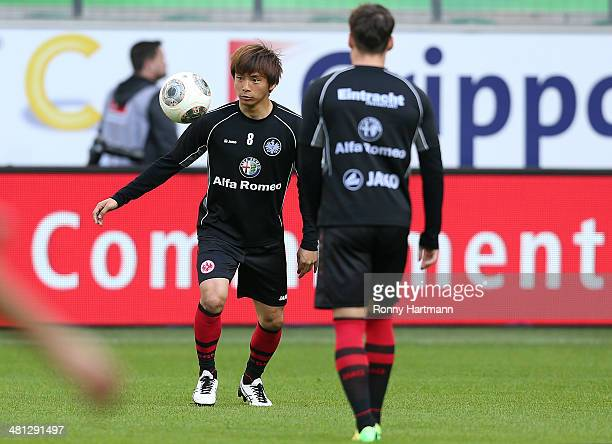 Takashi Inui and Stefano Celozzi of Frankfurt warm up prior to the Bundesliga match between VfL Wolfsburg and Eintracht Frankfurt at Volkswagen Arena...