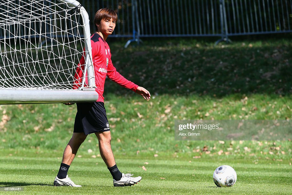 Takashi Inui carries a goal during an Eintracht Frankfurt training session at Commerzbank Arena on April 2 2014 in Frankfurt am Main Germany