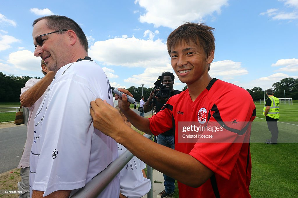 Takashi Inui gives autographs after the training session of Eintracht Frankfurt at the training ground at Commerzbank Arena on July 3 2012 in...