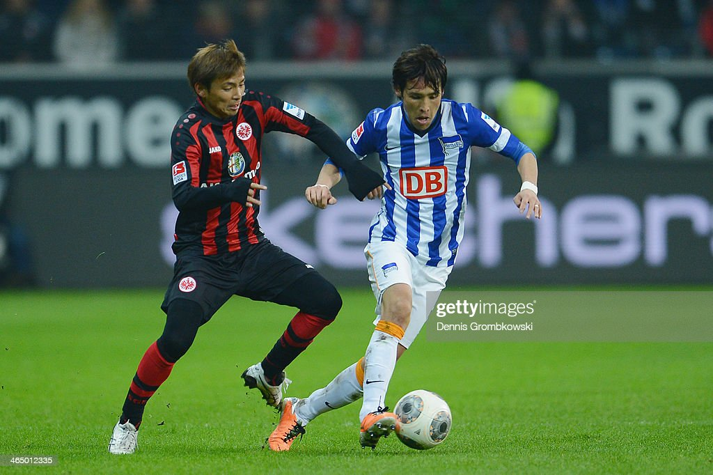 <a gi-track='captionPersonalityLinkClicked' href=/galleries/search?phrase=Takashi+Inui&family=editorial&specificpeople=7174976 ng-click='$event.stopPropagation()'>Takashi Inui</a> of Eintracht Frankfurt and <a gi-track='captionPersonalityLinkClicked' href=/galleries/search?phrase=Hajime+Hosogai&family=editorial&specificpeople=4023693 ng-click='$event.stopPropagation()'>Hajime Hosogai</a> of Hertha BSC battle for the ball during the Bundesliga match between Eintracht Frankfurt and Hertha BSC at Commerzbank Arena on January 25, 2014 in Frankfurt am Main, Germany.