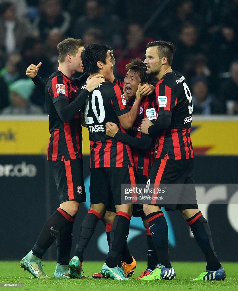 Takashi Inui of Eintracht Frankfurt celebrates as he scores their third goal during the Bundesliga match between Borussia Moenchengladbach and...
