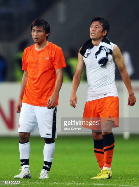 Takashi Inui of Frankfurt and Yusuke Tasaka of Bochum chat after the DFB Cup second round match between Eintracht Frankfurt and VfL Bochum at...