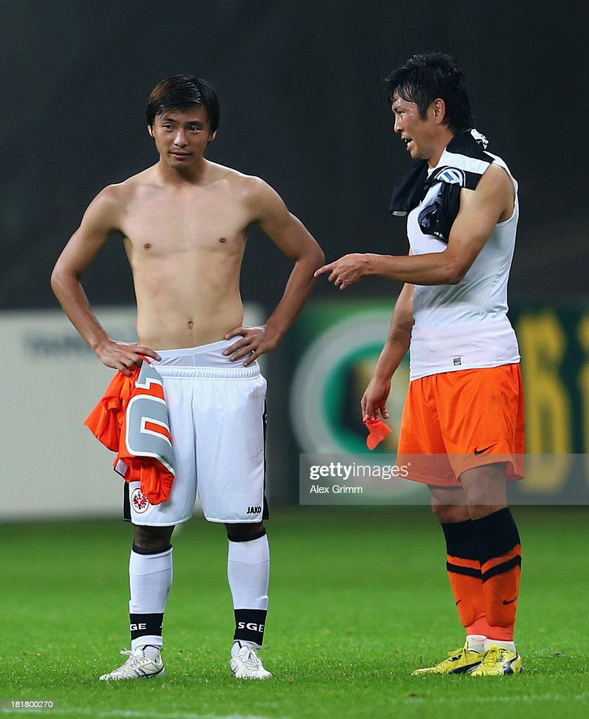 Takashi Inui (L) of Frankfurt and Yusuke Tasaka of Bochum chat after the DFB Cup second round match between Eintracht Frankfurt and VfL Bochum at Commerzbank-Arena on September 25, 2013 in Frankfurt am Main, Germany.