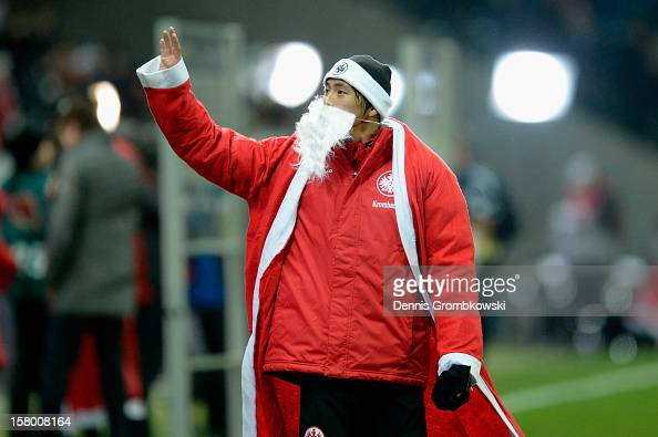 Takashi Inui of Frankfurt celebrates dressed as Santa Claus after the Bundesliga match between Eintracht Frankfurt and SV Werder Bremen at...
