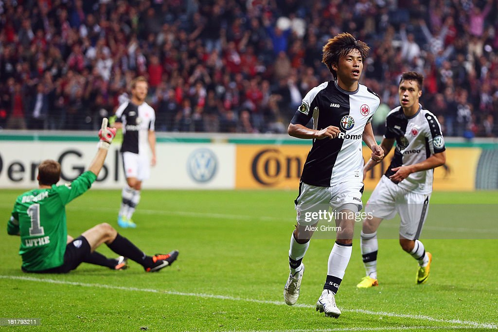 <a gi-track='captionPersonalityLinkClicked' href=/galleries/search?phrase=Takashi+Inui&family=editorial&specificpeople=7174976 ng-click='$event.stopPropagation()'>Takashi Inui</a> of Frankfurt celebrates his team's first goal during the DFB Cup second round match between Eintracht Frankfurt and VfL Bochum at Commerzbank-Arena on September 25, 2013 in Frankfurt am Main, Germany.