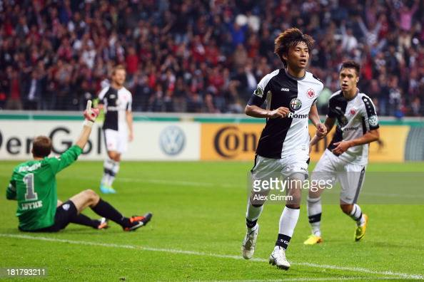 Takashi Inui of Frankfurt celebrates his team's first goal during the DFB Cup second round match between Eintracht Frankfurt and VfL Bochum at...