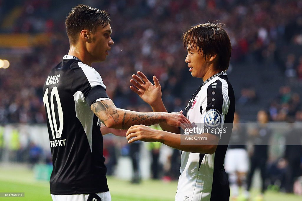 Takashi Inui (R) of Frankfurt celebrates his team's first goal with team mate Vaclav Kadlec during the DFB Cup second round match between Eintracht Frankfurt and VfL Bochum at Commerzbank-Arena on September 25, 2013 in Frankfurt am Main, Germany.