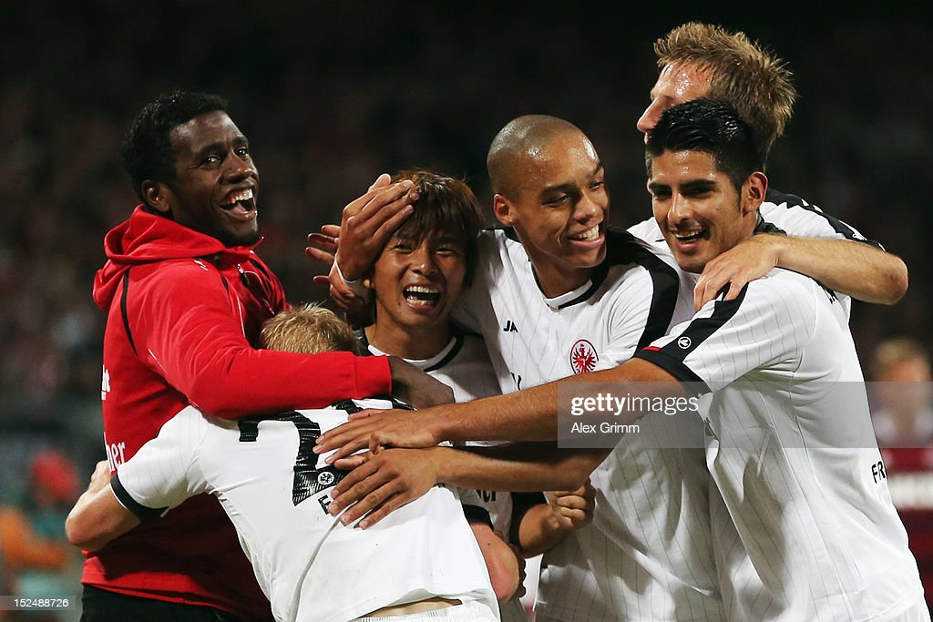 <a gi-track='captionPersonalityLinkClicked' href=/galleries/search?phrase=Takashi+Inui&family=editorial&specificpeople=7174976 ng-click='$event.stopPropagation()'>Takashi Inui</a> (3L) of Frankfurt celebrates his team's second goal with team mates during the Bundesliga match between 1. FC Nuernberg and Eintracht Frankfurt at Easy Credit Stadium on September 21, 2012 in Nuremberg, Germany.