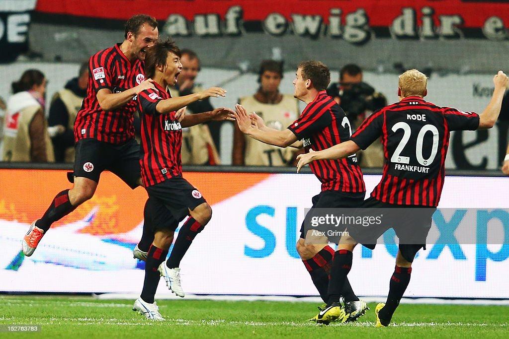 Takashi Inui of Frankfurt celebrates his team's second goal with team mates Stefan Aigner Sebastian Jung and Sebastian Rode during the Bundesliga...