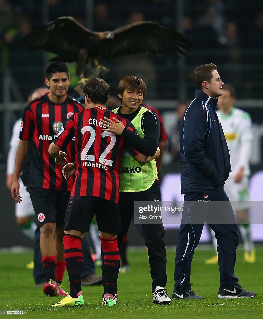 Takashi Inui of Frankfurt celebrates with team mate Stefano Celozzi after the Bundesliga match between Eintracht Frankfurt and Borussia...