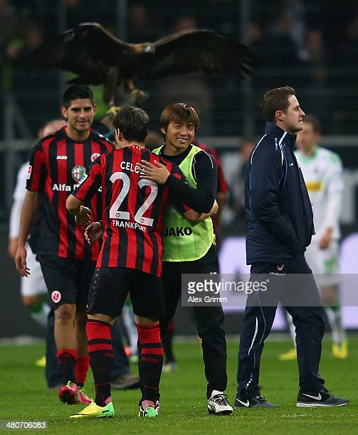 Takashi Inui of Frankfurt celebrates with team mate Stefano Celozzi after the Bundesliga match between Eintracht Frankfurt and Borussia...