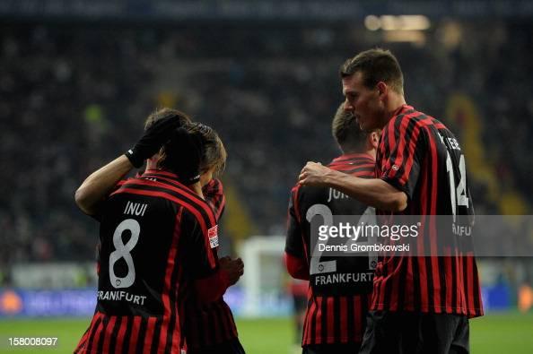 Takashi Inui of Frankfurt celebrates with teammates after scoring during the Bundesliga match between Eintracht Frankfurt and SV Werder Bremen at...