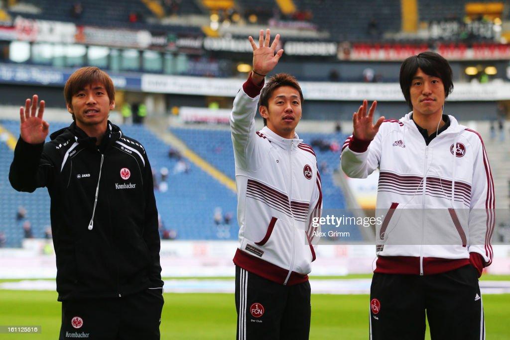 Takashi Inui of Frankfurt Hiroshi Kiyotake and Mu Kanazaki of Nuernberg wave to supporters prior to the Bundesliga match between Eintracht Frankfurt...
