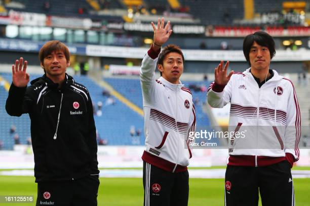 Takashi Inui of Frankfurt Hiroshi Kiyotake and Mu Kanazaki of Nuernberg wave to supporters prior to the Bundesliga match between Eintracht Frankfurt...