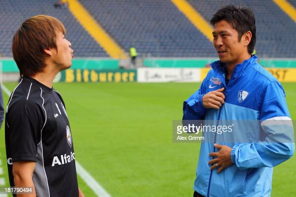 Takashi Inui of Frankfurt is challenged by chats with Yusuke Tasaka of Bochum prior to the DFB Cup second round match between Eintracht Frankfurt and...