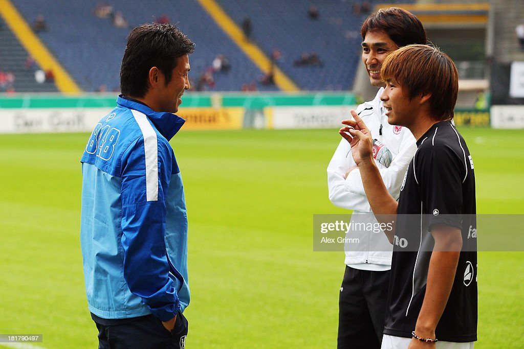 Takashi Inui (R) of Frankfurt is challenged by chats with Yusuke Tasaka of Bochum prior to the DFB Cup second round match between Eintracht Frankfurt and VfL Bochum at Commerzbank-Arena on September 25, 2013 in Frankfurt am Main, Germany.