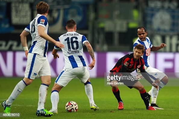 Takashi Inui of Frankfurt is challenged by Peter Niemeyer Julian Schieber and Ronny of Berlin during the Bundesliga match between Eintracht Frankfurt...
