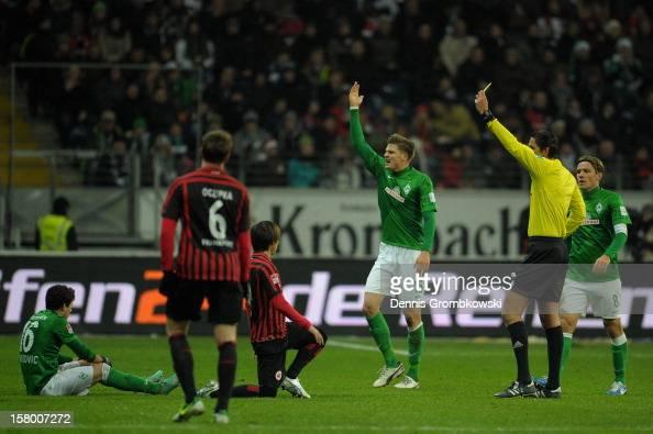 Takashi Inui of Frankfurt is shown a yellow card by referee Deniz Aytekin during the Bundesliga match between Eintracht Frankfurt and SV Werder...