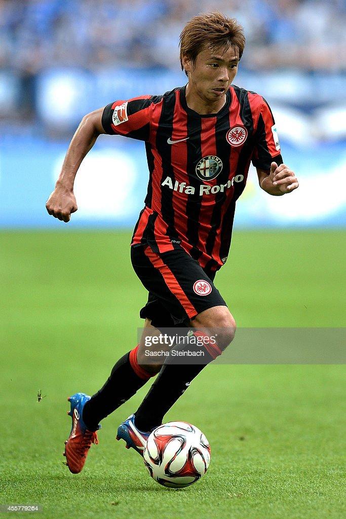 Takashi Inui of Frankfurt runs with the ball during the Bundesliga match between FC Schalke 04 and Eintracht Frankfurt at Veltins Arena on September...