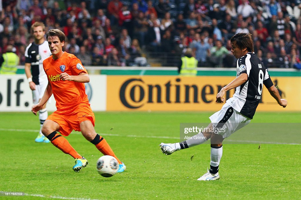 Takashi Inui of Frankfurt scores his team's first goal against Jonas Acquistapace of Bochum during the DFB Cup second round match between Eintracht Frankfurt and VfL Bochum at Commerzbank-Arena on September 25, 2013 in Frankfurt am Main, Germany.