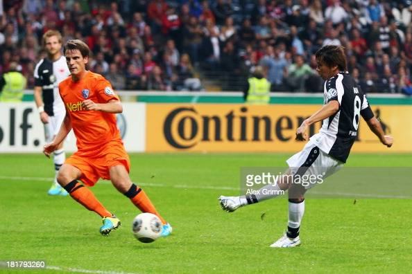 Takashi Inui of Frankfurt scores his team's first goal against Jonas Acquistapace of Bochum during the DFB Cup second round match between Eintracht...