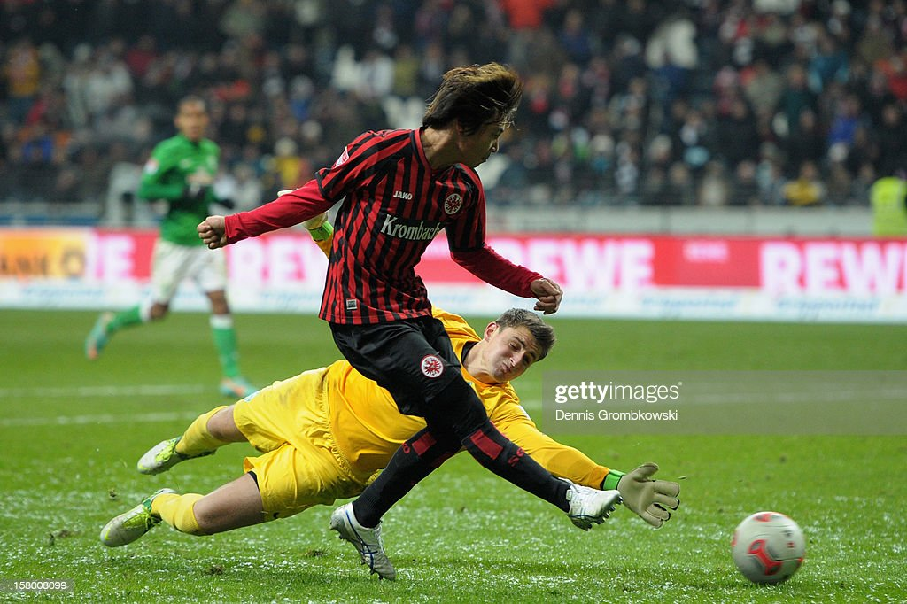 Takashi Inui of Frankfurt scores his team's fourth goal during the Bundesliga match between Eintracht Frankfurt and SV Werder Bremen at...