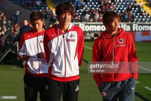 Takashi Inui of Frankfurt Yuya Osako and Kazuki Nagasawa of Koeln talk prior to the Bundesliga match between Eintracht Frankfurt and 1 FC Koeln at...