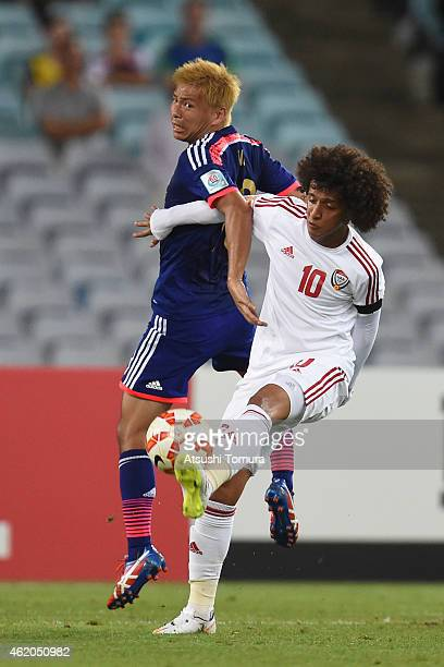 Takashi Inui of Japan competes with Omar Abdulrahman of the United Arab Emirates during the 2015 Asian Cup Quarter Final match between Japan and the...