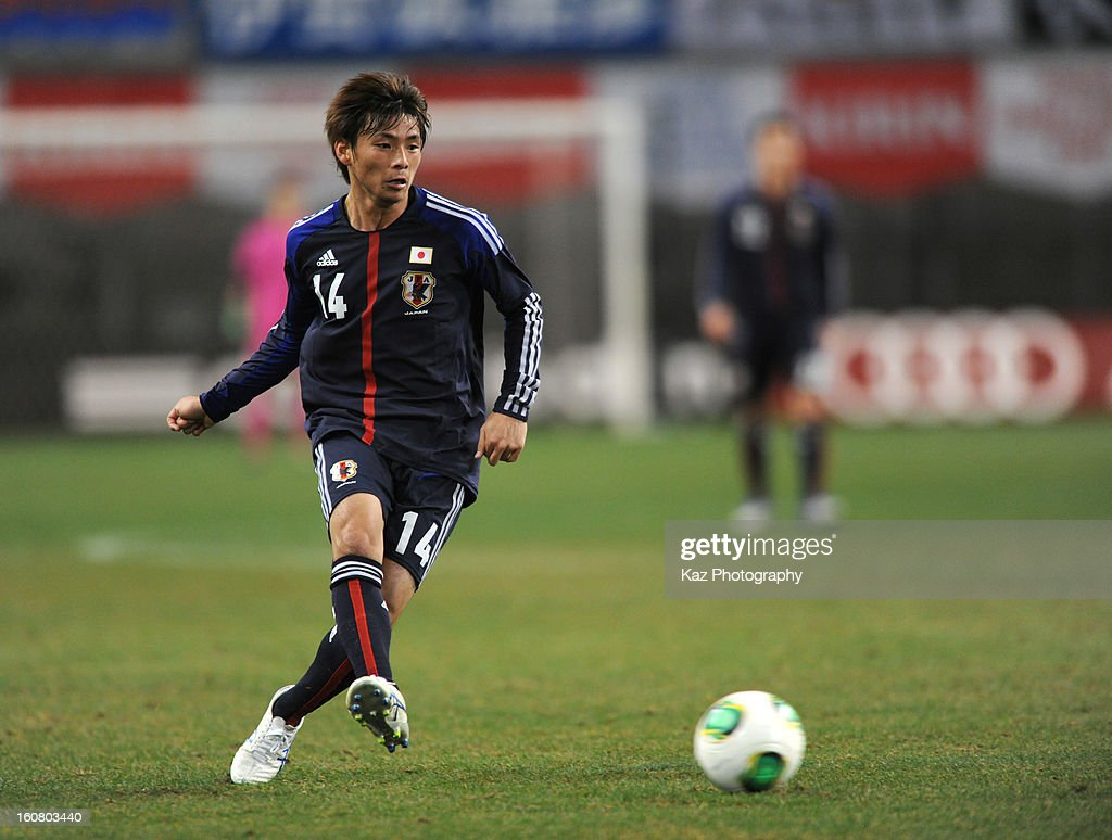 <a gi-track='captionPersonalityLinkClicked' href=/galleries/search?phrase=Takashi+Inui&family=editorial&specificpeople=7174976 ng-click='$event.stopPropagation()'>Takashi Inui</a> of Japan passes the ball during the international friendly match between Japan and Latvia at Home's Stadium Kobe on February 6, 2013 in Kobe, Japan.
