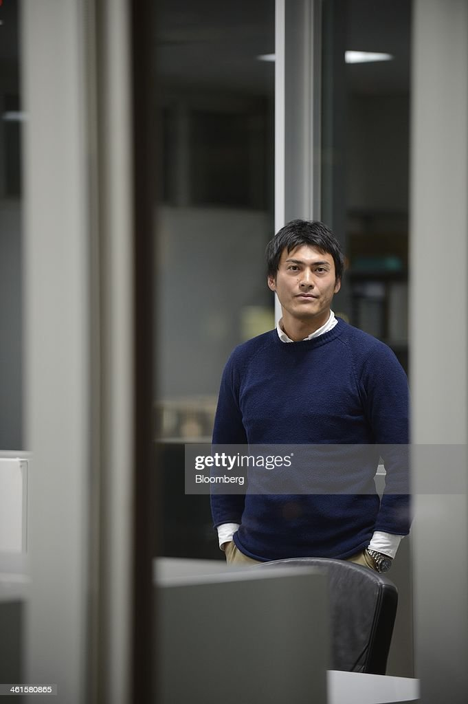 Takashi Kato, chief executive officer of 246 Capital, poses for a photograph in his office in Tokyo, Japan, on Thursday, Jan. 9, 2014. Kato, co-founder of the robot venture Schaft Inc. bought by Google Inc. in November, opened a fund to invest in technologies from Japanese startups and universities that have been overlooked by investors. Photographer: Akio Kon/Bloomberg via Getty Images