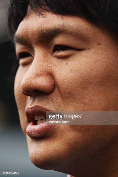 Takashi Kikutani of the Japan IRB Rugby World Cup 2011 team greets fans after arriving at Auckland International Airport on August 31 2011 in...