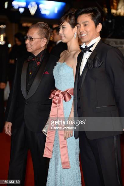 Takashi Miike Nanako Matsushima and Takao Osawa attend the Premiere of 'Wara No Tate' during the 66th Annual Cannes Film Festival at the Palais des...