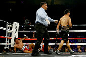 Takashi Miura knocks down Francisco Vargas in the fourth round during their WBC super featherweight title fight at the Mandalay Bay Events Center on...