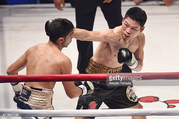 Takashi Miura of Japan and Billy Dib of Australia exchange puches duing the WBC world super featherweight title bout between Takashi Miura of Japan...