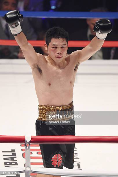 Takashi Miura of Japan celebrates as Billy Dib of Australia downs in the thirdround duing the WBC world super featherweight title bout between...