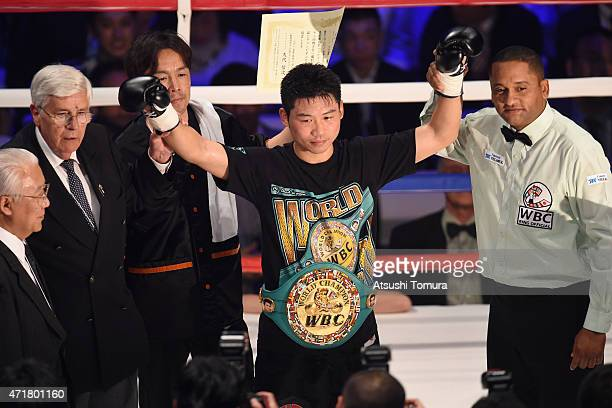 Takashi Miura of Japan celebrates his thirdround knockout victory over Billy Dib of Australia duing the WBC world super featherweight title bout...