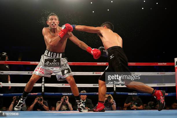 Takashi Miura punches Miguel Berchelt in the ninth round of WBC Super Featherweight Title Fight at The Forum on July 15 2017 in Inglewood California