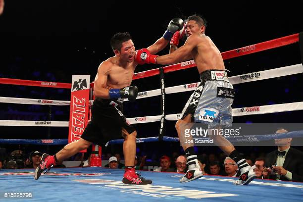 Takashi Miura punches Miguel Berchelt in the twelfth round of WBC Super Featherweight Title Fight at The Forum on July 15 2017 in Inglewood California