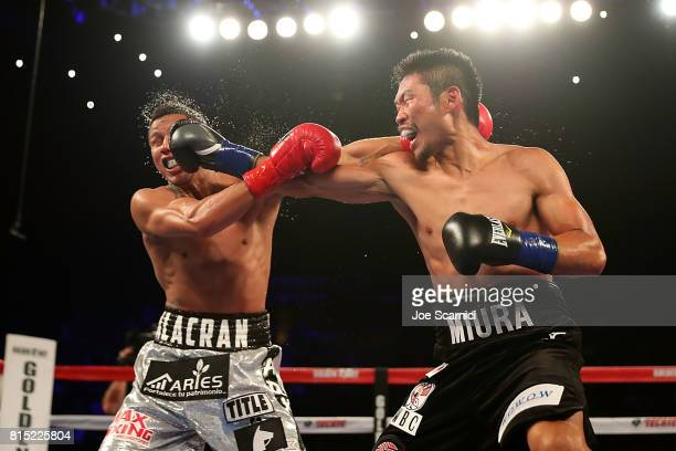 Takashi Miura sends a right punch to connect with Miguel Berchelt in the face during the WBC Super Featherweight Title Fight at The Forum on July 15...