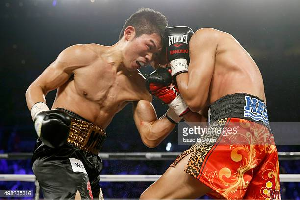 Takashi Miura throws a left to the face of Francisco Vargas during their WBC super featherweight title fight at the Mandalay Bay Events Center on...