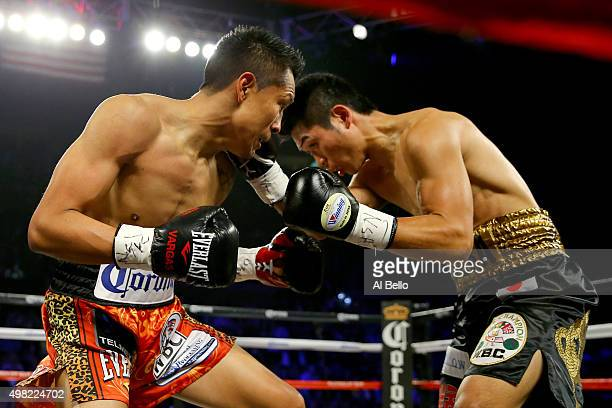 Takashi Miura throws a right to the face of Francisco Vargas during their WBC super featherweight title fight at the Mandalay Bay Events Center on...