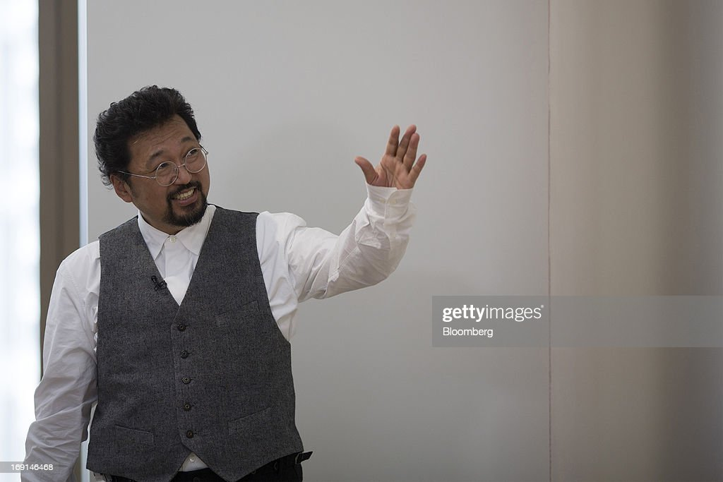 Takashi Murakami, a Japanese contemporary artist, gestures during an interview at the Galerie Perrotin in Hong Kong, China, on Monday, May 20, 2013. The exhibition 'Takashi Murakami' will be on show until July 6. Photographer: Jerome Favre/Bloomberg via Getty Images