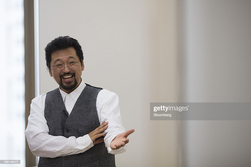 <a gi-track='captionPersonalityLinkClicked' href=/galleries/search?phrase=Takashi+Murakami&family=editorial&specificpeople=588180 ng-click='$event.stopPropagation()'>Takashi Murakami</a>, a Japanese contemporary artist, gestures during an interview at the Galerie Perrotin in Hong Kong, China, on Monday, May 20, 2013. The exhibition '<a gi-track='captionPersonalityLinkClicked' href=/galleries/search?phrase=Takashi+Murakami&family=editorial&specificpeople=588180 ng-click='$event.stopPropagation()'>Takashi Murakami</a>' will be on show until July 6. Photographer: Jerome Favre/Bloomberg via Getty Images