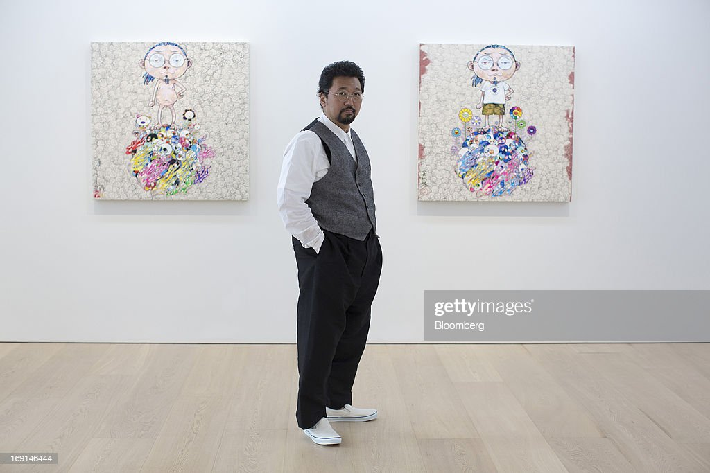 <a gi-track='captionPersonalityLinkClicked' href=/galleries/search?phrase=Takashi+Murakami&family=editorial&specificpeople=588180 ng-click='$event.stopPropagation()'>Takashi Murakami</a>, a Japanese contemporary artist, poses for a photograph in front of his paintings on exhibit at the Galerie Perrotin in Hong Kong, China, on Monday, May 20, 2013. The exhibition '<a gi-track='captionPersonalityLinkClicked' href=/galleries/search?phrase=Takashi+Murakami&family=editorial&specificpeople=588180 ng-click='$event.stopPropagation()'>Takashi Murakami</a>' will be on show until July 6. Photographer: Jerome Favre/Bloomberg via Getty Images