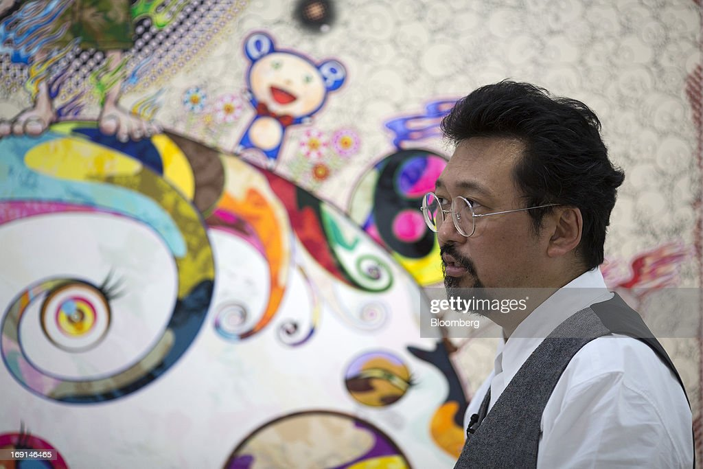 Takashi Murakami, a Japanese contemporary artist, speaks during an interview at the Galerie Perrotin in Hong Kong, China, on Monday, May 20, 2013. The exhibition 'Takashi Murakami' will be on show until July 6. Photographer: Jerome Favre/Bloomberg via Getty Images