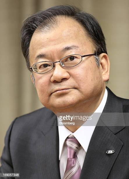 Takashi Okuda president of Sharp Corp attends a group interview at the company's headquarters in Osaka Japan on Monday Jan 7 2013 Sharp Corp Japan's...